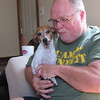 Staff photo by Cathy Spaulding<br /> Mark Haile cuddles the family dog. Haile is a counselor at Muskogee Public Schools' Camp Bennett, a Special Olympics coach, and a bivocational pastor at Brushy Mountain Baptist Church.