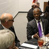 Staff photo by Harrison Grimwood<br /> Former U.S. Rep. J.C. Watts speaks with Muskogee Mayor Bob Coburn during a fundraising gala Friday night at the Martin Luther King Jr. Community Center.