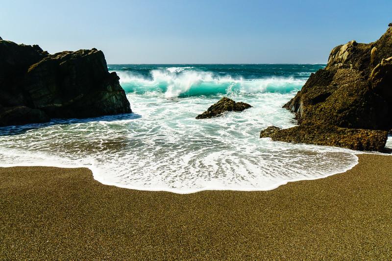 A crashing ocean wave in Point Lobos State Park near Carmel-By-The-Sea, California.