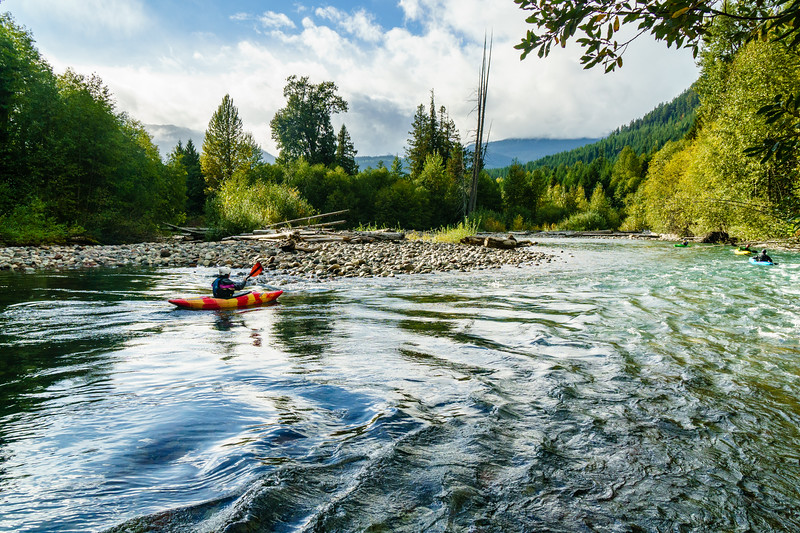 Daphnee Tuzlak enjoys the fall colors on the Cheakamus River near Whistler, British Columbia.