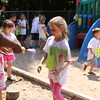 Staff photo by Harrison Grimwood<br /> Jovie Byrd, 5, runs into a color stream, collecting a spurt of purple powder Friday during a color run at the Jack and Jill Learning Center.
