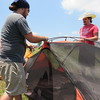 Staff photo by Cathy Spaulding<br /> Tyler Shadid, left, and Logan Gemaehlich of Norman set up a tent Wednesday at the venue.