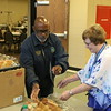 Staff photo by Harrison Grimwood<br /> City Councilor Ivory Vann, left, and Judy Hoffman box up food left over from an Action In Muskogee update meeting Thursday to take to the Gospel Rescue Mission.