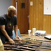 Staff photo by Harrison Grimwood<br /> Muskogee Sheriff's Lt. Tyler Mohr takes stock of firearms confiscated Monday during a drug raid.