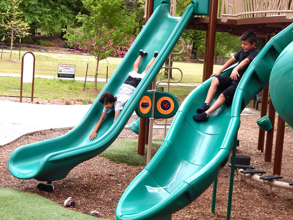 """Staff photo by Mark Hughes<br /> Eric Walters, 12, and his brother Jack, 9, enjoy the slides at the playground at Honor Heights Park on Wednesday. They were """"burning off energy"""" after a dental appointment and lunch, their mother, Jamie, said."""