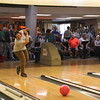 Staff photo by Harrison Grimwood<br /> Felicia Didway of BancFirst goes for a strike during the Junior Achievement Super Hero Bowl on Thursday night at Green Country Lanes.