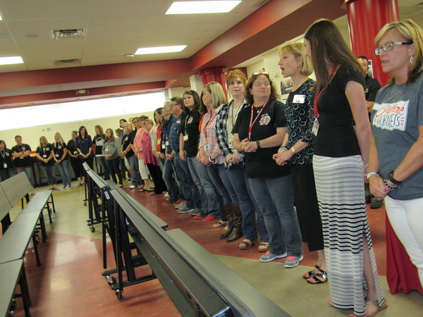 Staff photo by Cathy Spaulding<br /> Hilldale Education Foundation grant applicants line up Thursday in the Hilldale High School cafeteria, waiting to learn whether they would receive a grant. The foundation fulfilled all 42 grant requests.
