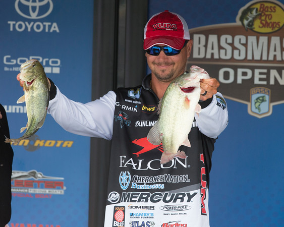 Special photo by Von Castor<br /> Jason Christie of Park Hill shows some of his catch during first-round weigh-ins in the Bassmaster Bass Pro Shops Central Open #1 at Three Forks Harbor.