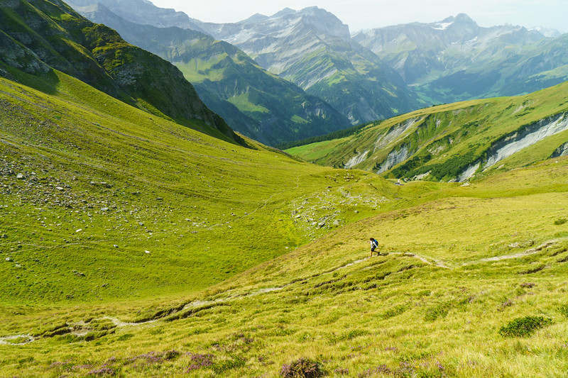 Daphnee Tuzlak begins the descent towards Elm from Foo Pass, Switzerland.