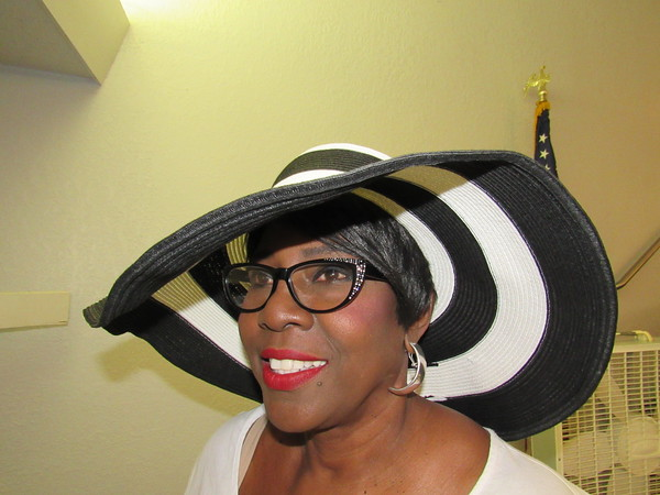 Staff photo by Cathy Spaulding<br /> Doretha Beasley wears a favorite straw summer hat. She said she has about 60 hats.