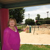 Staff photo by Cathy Spaulding<br /> EASTAR Child Development Center Director Sherry Grooms shows its newly landscaped sandbox and playground, with sand used for the play- ground in the background.