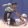 Phoenix special photo by Von Castor<br /> Muskogee's Dee Emarthle, left, tags out a Broken Bow base runner during Tuesday's Class 6A quarterfinal at ASA Hall of Fame Stadium.