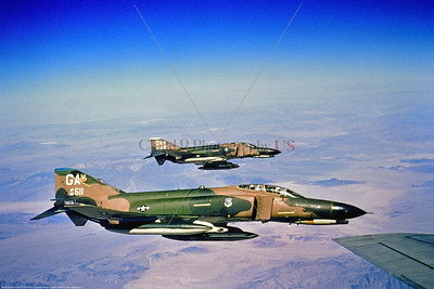 F-4IIUSAF-35TFW 002 A pair of McDouglas F-4E Phantom II USAF jet fighters 35th TFW GA tail code over a desert while aerial refueling 1974 military airplane picture by Robert Bradley via Stephen W  D  Wolf coll      BBB_6291     DoneWT