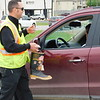 KENTON BOOKS/Muskogee Phoenix<br /> City of Muskogee firefighter Jody Moore thanks a motorist on Shawnee Bypass for her donation to the firefighters' Fill the Boot drive for the Muscular Dystrophy Association. City of Muskogee firefighters lined up at the corners of Main Street and Shawnee Bypass as well as York Street and Chandler Road on Thursday for the annual Fill the Boot Drive for the Muscular Dystrophy Association. The Muskogee firefighters participate in the drive annually. An estimated $4,000 was raised last year, said firefighter Matthew Pitman. The drive continues 9 a.m. to 1 p.m. today and Saturday at the same two locations.