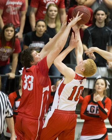 Special photo by Von Castor<br /> Fort Gibson's Cole Hamilton blocks the shot of Locust Grove's Aaron Halpain on Saturday night in the boys 4A area consolation finals at Brooks Walton Activity Center in Skiatook.