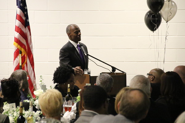 """Staff photo by Harrison Grimwood<br /> Former U.S. Rep. J.C. Watts addresses the crowd at the Martin Luther King Jr. Community Center. """"This is really a special sauce,"""" he said, referring to the cooperation that made the center a reality."""