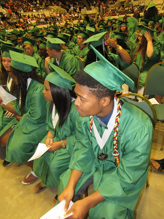 Staff photo by Cathy Spaulding<br /> Muskogee High School senior Caleb Carter wears an<br /> Engineering/Skills USA leadership cord and an honor<br /> medal while waiting for Thursday night's commencement<br /> ceremony.