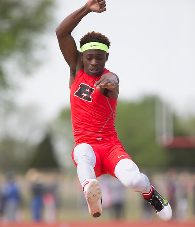 Phoenix special photo by Von Castor<br /> Hilldale's Tre Mitchell won the boys long jump on Friday<br /> at the Hilldale track and field meet with a leap of 18-feet, 7-inches — five inches ahead of his nearest competitor.