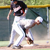 Special photo by John Hasler<br /> Tahlequah's Braden Cobb beats the throw to third base as Muskogee's Karrington Ashley fields the short hop during Tuesday's game at Muskogee High School.