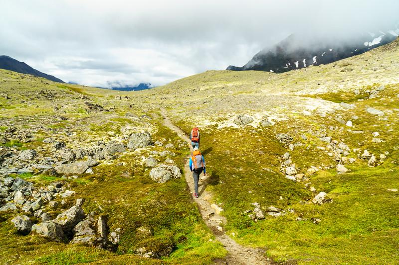 Tom Callahan and Abra Atwood crossing the summit of Crow Pass near Girdwood, Alaska.