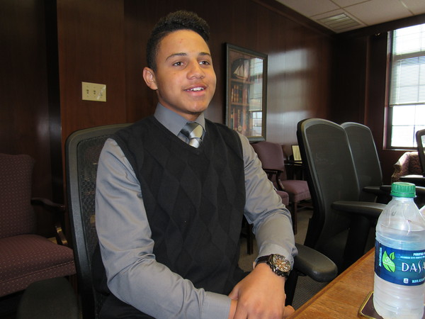 Staff photo by Cathy Spaulding<br /> Muskogee High School junior Izaeah Washington seeks to help others dress professionally by helping the city collect business attire.
