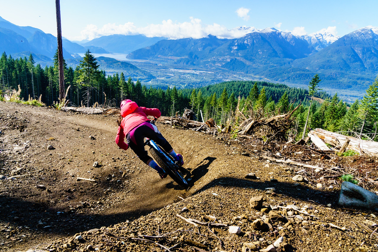 """Carolyn Stwertka rails a berm on """"Meadow of the Grizzly,"""" a trail in Squamish, British Columbia."""