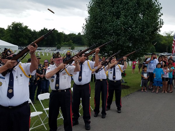 Staff photo by Mark Hughes<br /> The honor guard from American Legion Post 15 fires a volley during the closing ceremony Monday at Fort Gibson National Cemetery in commemoration of Memorial Day.