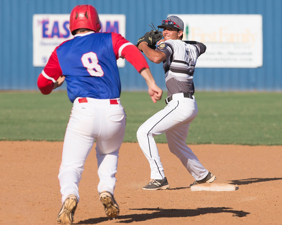 Special photo by Von Castor<br /> Three Rivers second baseman Cayden Cockle prepares to throw to first to finish off a double play as Ada's Dylan Lang slides into second base in the first game Tuesday at Checotah.