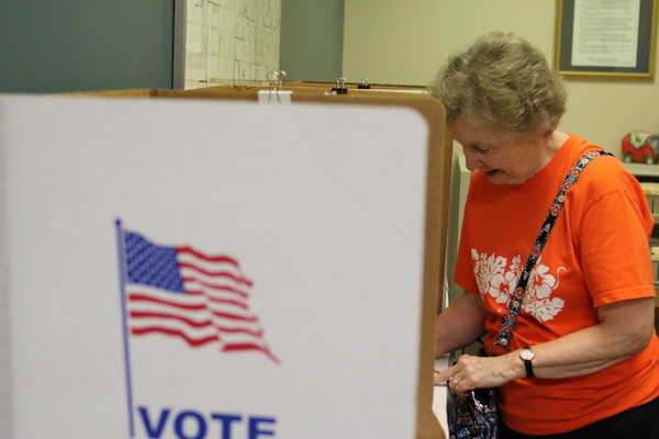 Staff photo by Harrison Grimwood<br /> Betty Luttrell makes her selections. Early voting resumes today from 9 a.m. to 2 p.m.