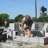 Staff photo by Cathy Spaulding<br /> Steve Schneider lays blocks for the Porter Peach Festival oven. The oven will bake what festival promoters hope will be the world's largest peach cobbler.