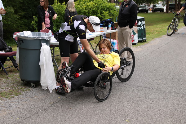 """Staff photo by Harrison Grimwood<br /> Patty Parmeter, a suicide prevention coordinator at the Jack<br /> C. Montgomery VA Medical Center, tries out a recumbent tricycle<br /> during the VA2K Walk and Roll. Parmeter ended her roll by saying<br /> """"exercise is good stress relief."""""""