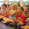 "Staff photo by Cathy Spaulding<br /> Youngsters applaud Ann Lincoln's juggling demonstration at the Q.B. Boydstun Library. Her show is named ""How I Learned to Juggle at My Library Show."""