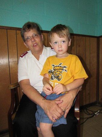 Staff photo by Cathy Spaulding<br /> Major Sue Dewan holds her 4-year-old grandson, Michael. Dewan came to Musk- ogee with her husband, Major Dave Dewan, to serve the Muskogee Salvation Army and to be closer to family members in Kansas.
