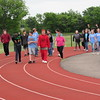 Staff photo by Cathy Spaulding<br /> Fort Gibson Middle School students circle the school's running track during a walk-a-thon. The event helped raise money to send soccer balls to African children.