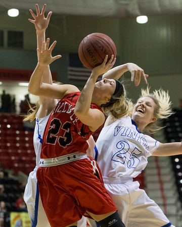 Special photo by Von Castor<br /> Hilldale's Katie Kirkhart is fouled as she drives in the lane by Vinita's Bailey Orr on Saturday night in the Class 4A Area II consolation final in Skiatook.