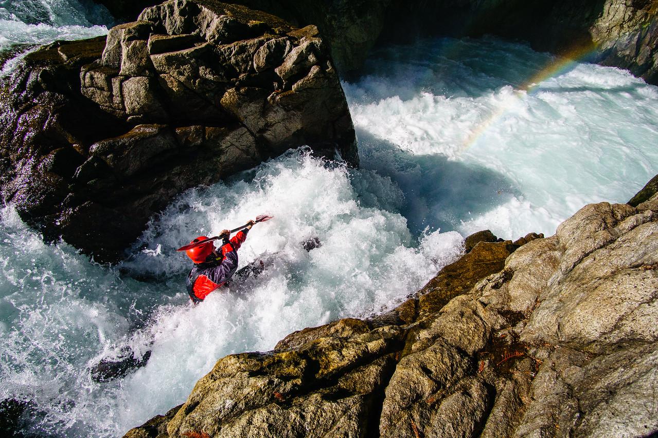 Jonah Shaw boofs into a rainbow on the Upper Cheakamus River near Whistler, British Columbia.
