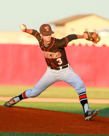 Special photo by Samuel Perry<br /> Braden Cobb delivers a pitch for Tahlequah against Shawnee in the Class 5A baseball quarterfinals Thursday.