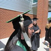 Staff photo by Cathy Spaulding<br /> Bobby Burris of Tahlequah wears beads and a feather on her mortarboard as she prepares to graduate from Northeastern State University on Saturday. Burris majored in business management.