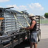 Staff photo by Cathy Spaulding<br /> Corey Cupp with Small Pocket Poets Agency secures stage decks on a trailer while packing up after G Fest. The agency supplied three stages at G Fest, held Thursday through Saturday at Love-Hatbox Sports Complex.
