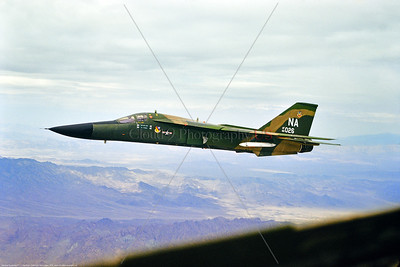 F-111USAF 0004 A General Dynamic Aardark F-111E USAF jet fighter bomber 66026 474 TFW NA code flying near Nellis AFB 7-1975 miliary airplane picture by Don Logan via Stephen W  D  Wolf coll      BBB_6131     DoneWT