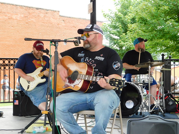 KENTON BROOKS/Muskogee Phoenix<br /> Billy Arnett leads The Billy Arnett Band at the Fort Gibson Community Party downtown Saturday.