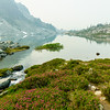 A smoky haze and wildflowers surrounding the aptly named Arrowhead Lake near Pemberton, British Columbia.