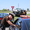 Staff photo by Harrison Grimwood<br /> Oklahoma Highway Patrol troopers investigate a two-vehicle collision that occurred at approximately 1:10 p.m. Friday. Troopers have not released the identities of those involved. A white Chevrolet pickup with no passengers was northbound on U.S. 69 when another white Chevrolet pickup with two passengers attempted to cross the highway eastbound on West 40th Street North, Trooper Josh Lawson said. The two passengers and two drivers were transported to area hospitals with serious injuries, Lawson said. The northbound vehicle struck the front-end side of the other vehicle while it attempted to cross the highway, Lawson said. As of press time, the trooper's report had not been released.