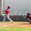 Special photo by John Hasler<br /> Stigler's Cameron Highfill, left, drives in two runs with a single to right in the first inning as Warner's Triston Vandelay watches during their game on Monday at Warner. The Panthers beat the Eagles 6-3.