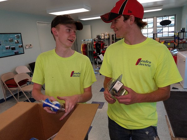 Staff photo by Mark Hughes<br /> Tristan Hill and Teddy Hammond unpack a box of supplies for Three Forks Outfitters, a new business at Three Forks Harbor. The business rents kayaks and paddle boats and sells fishing and hiking equipment.