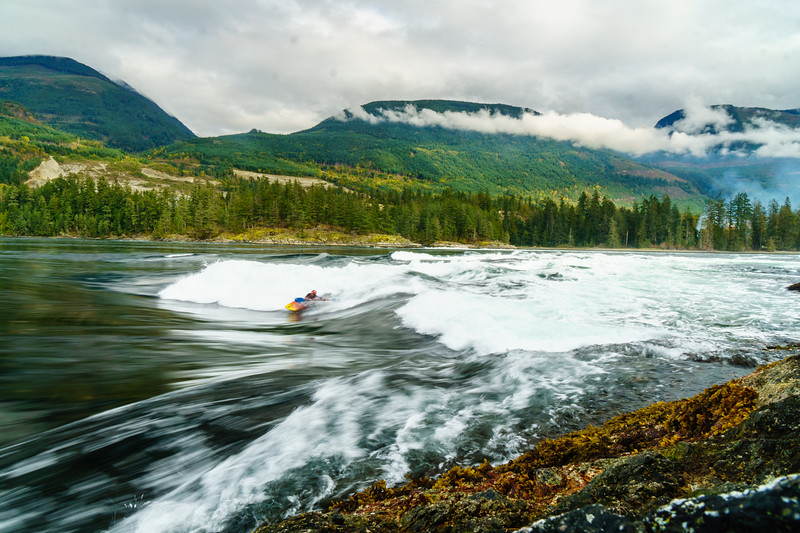 Ash Bullivant carving turns on the wave at Skookumchuck Narrows Provincial Park in British columbia.