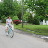 Staff photo by Cathy Spaulding<br /> Betty Hall rides her bike home from a Monday afternoon trip to ALPS grocery store. She made it home even as storm clouds loomed overhead.
