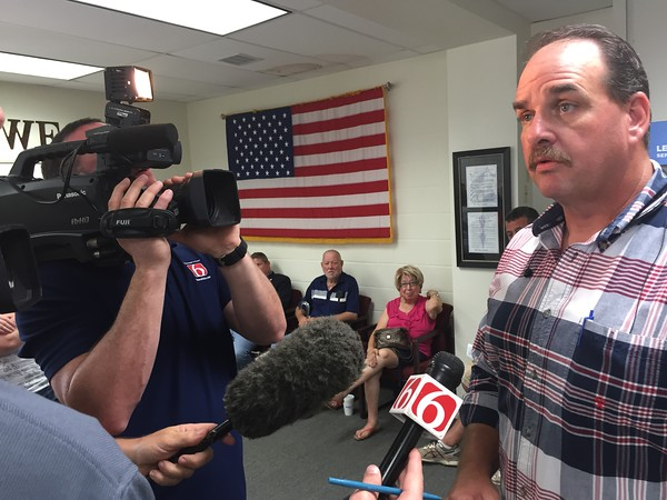 Staff photo by D.E. Smoot<br /> Wagoner County Sheriff-elect Chris Elliott fields questions Friday after six provisional ballots added to the primary election tally fell in his favor, eliminating the need for a runoff election.