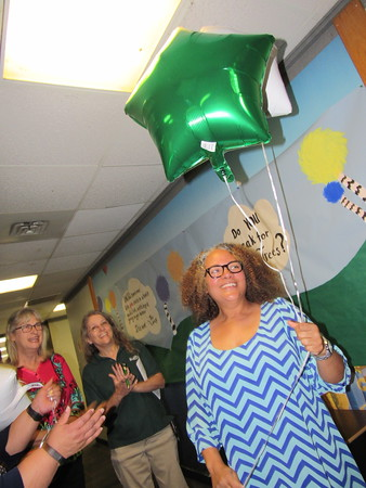 Staff photo by Cathy Spaulding<br /> Education Foundation of Muskogee representatives applaud Ben Franklin Science Academy teacher Valerie Ragsdale, right, as she accepts a $1,564 grant. Ragsdale will use the grant to enhance science and art learning for pre-kindergarten through second grade.