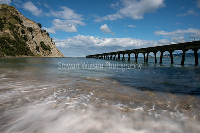 The historic pier at Tokomaru bay vanishing into the distance at New Zealand's east coast